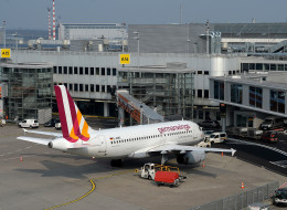 DUESSELDORF, GERMANY - MARCH 24:  An airplane from the type Airbus A319-100 of the German airline Germanwings stands on the airfield at Duesseldorf International Airport on March 24, 2015 in Duesseldorf, Germany. Germanwings flight 4U9525 from Barcelona to Duesseldorf with 150 people on board has crashed in the French Alps.  (Photo by Sascha Steinbach/Getty Images)